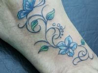 Flor-flower-mariposa-butterfly-filigrana-pie-color-colortattoo-tattoo-tatuaje-amor-de-madre-zamora
